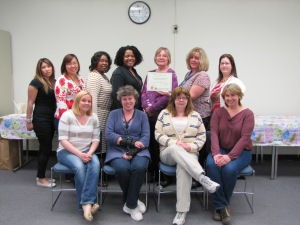 DPH Hinton State Laboratory employees show off their weight loss successes and certificate of recognition